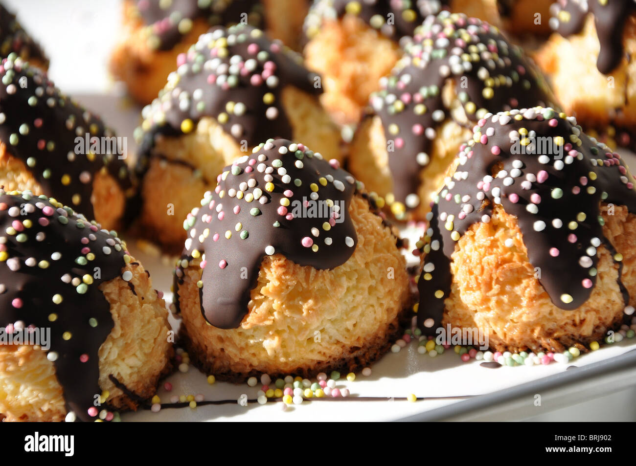 Coconut Macaroons with Chocolate and Sugar Candies served at a birthday party in Sweden - Stock Image