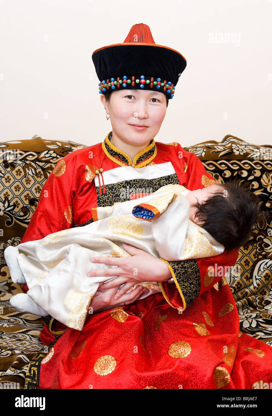 Mongolian woman holds her baby - Stock Image
