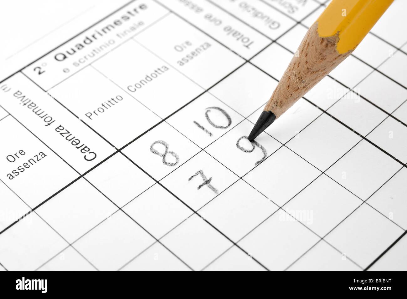 closeup of italian school report card with pencil - Stock Image