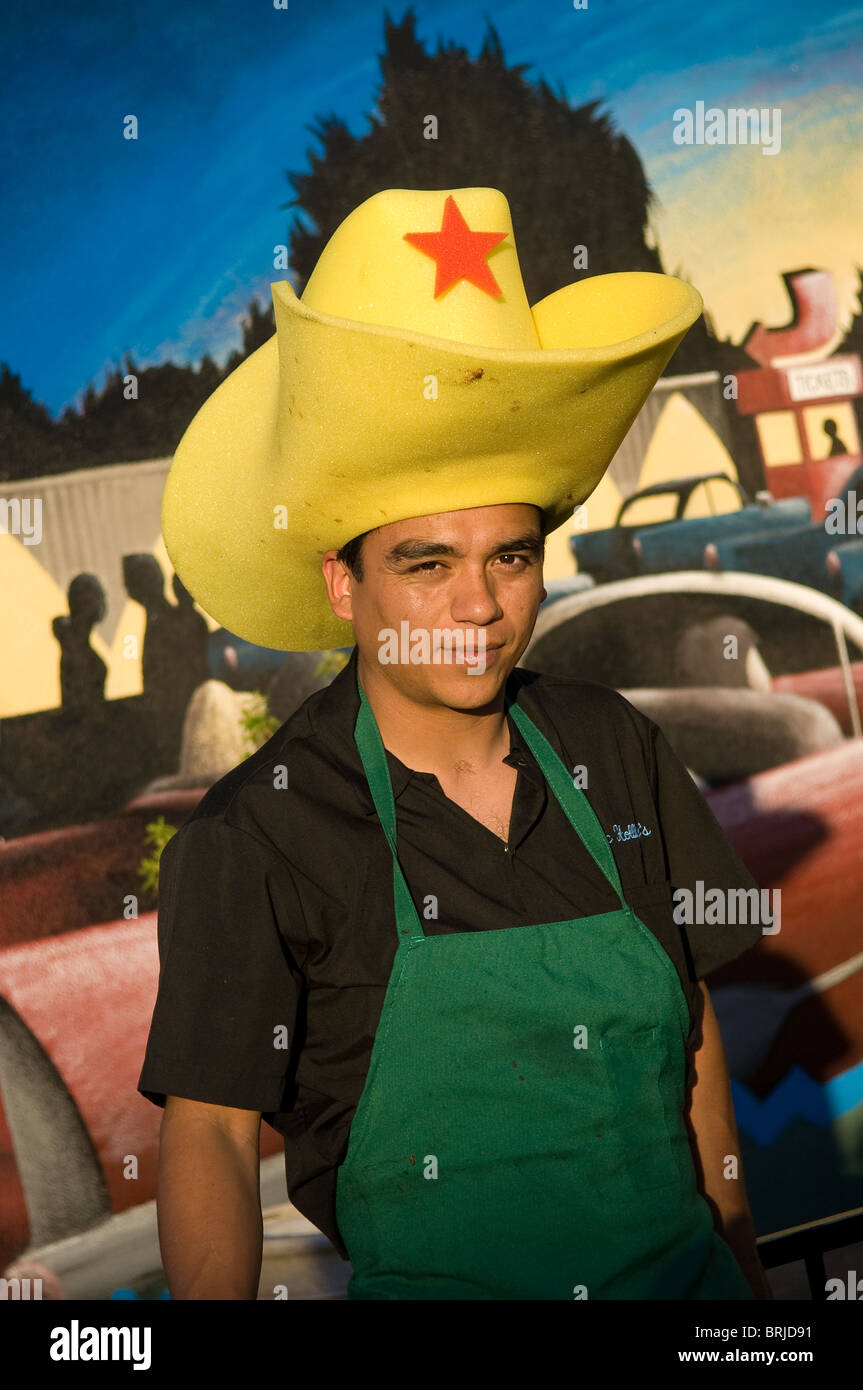 BBQ chef for Doc Holliday s Steakhouse wearing giant foam cowboy hat   Williams f68aa2c1e308