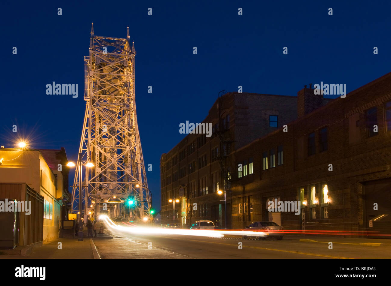 Aerial lift bridge in Duluth, Minnesota as seen from Canal Street at night. - Stock Image
