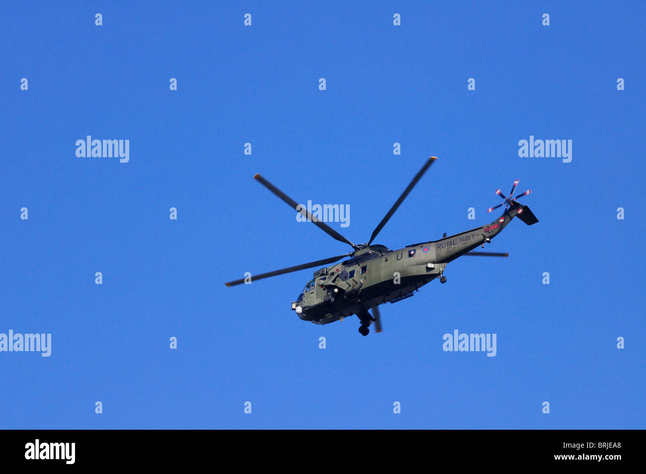 A Royal Navy  Westland Sea King HC.4 Helicopter flying over London, England, UK - Stock Image