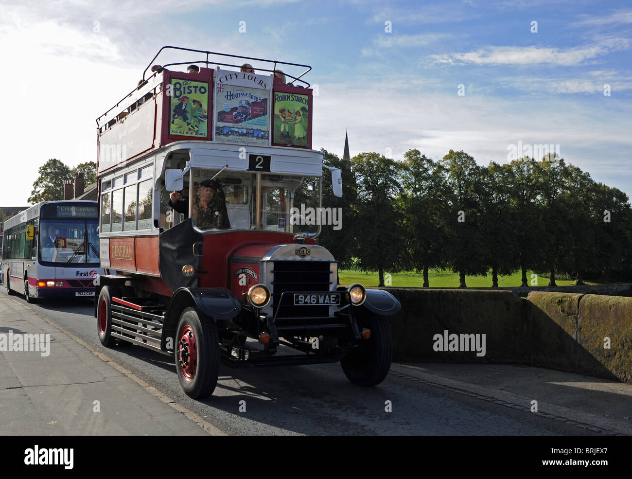 Open top vintage tourist bus in Chester city centre UK - Stock Image