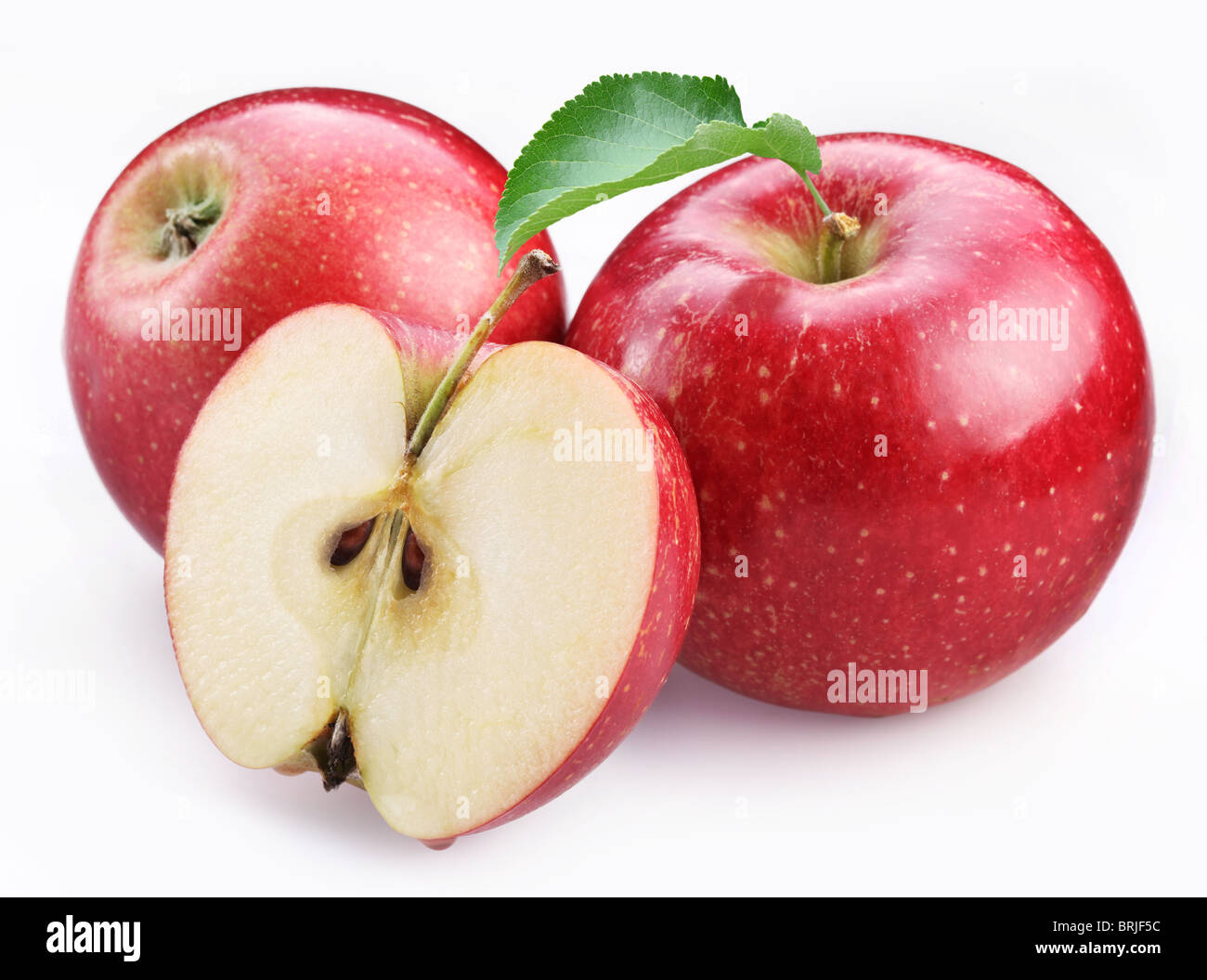 Two ripe red apples and half of apple. Isolated on a white background. - Stock Image