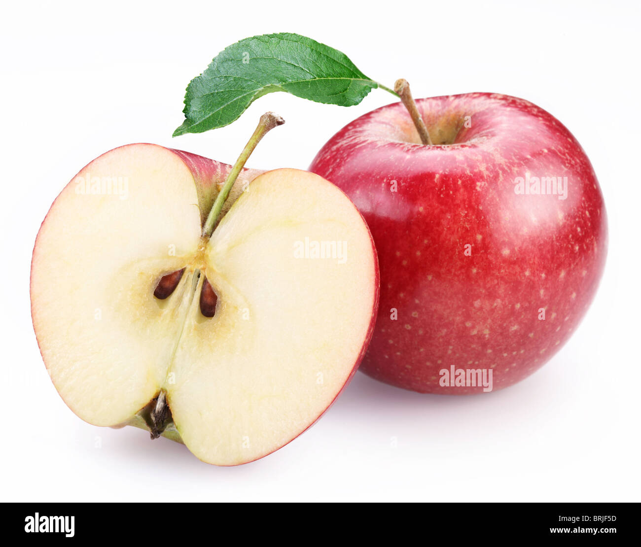 Red apple and half of red apple isolated on a white background. - Stock Image