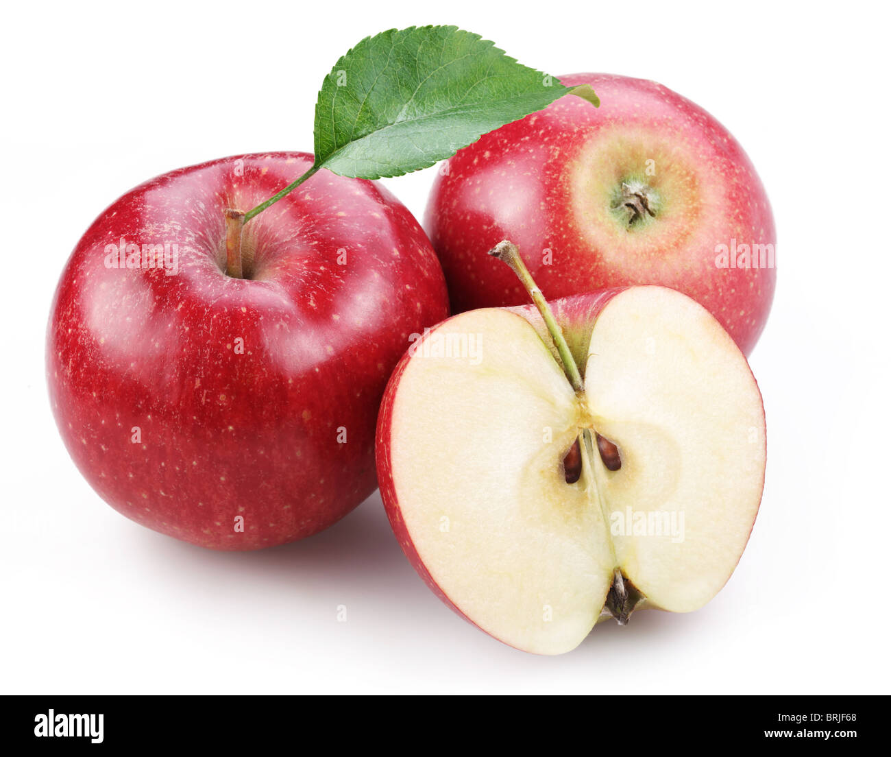 Two red apple and half of red apple isolated on a white background. - Stock Image