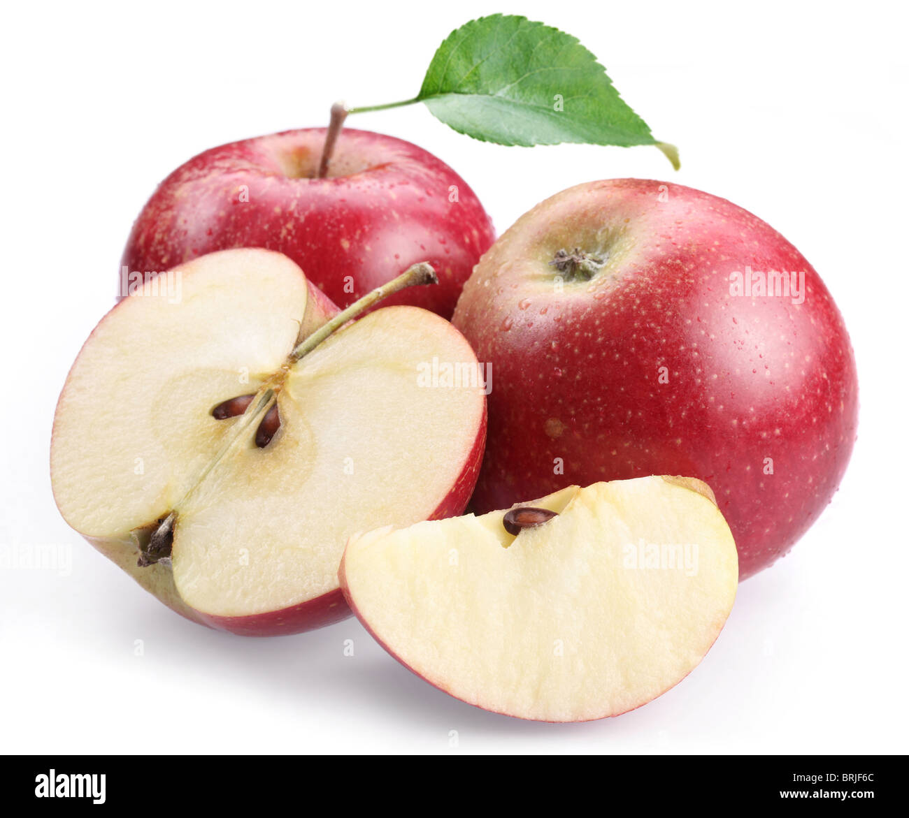 Two red apple with leaf and apple slices isolated on a white background. - Stock Image