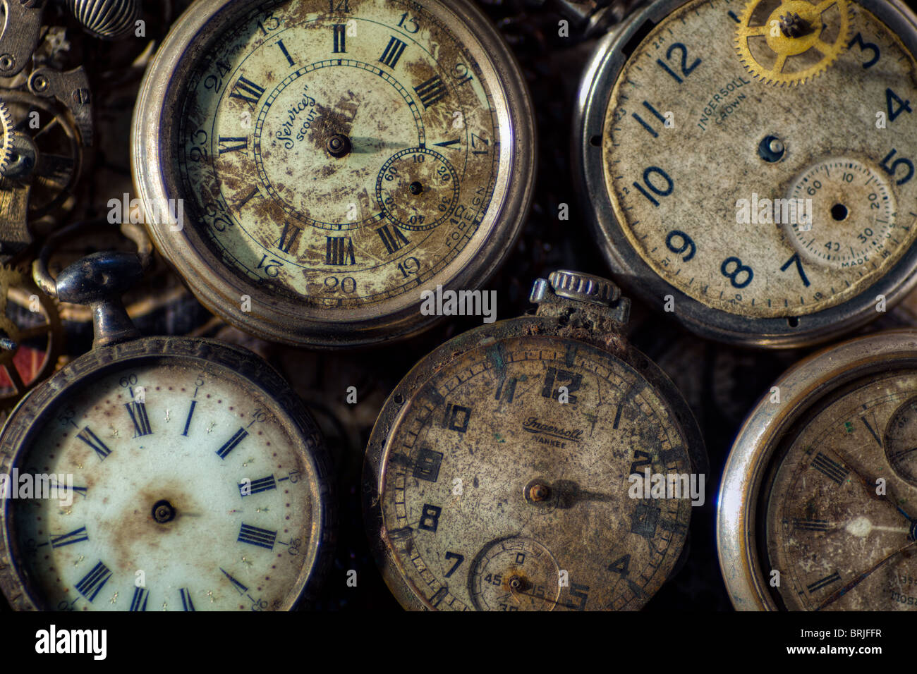 Broken old pocket watches and parts - Stock Image
