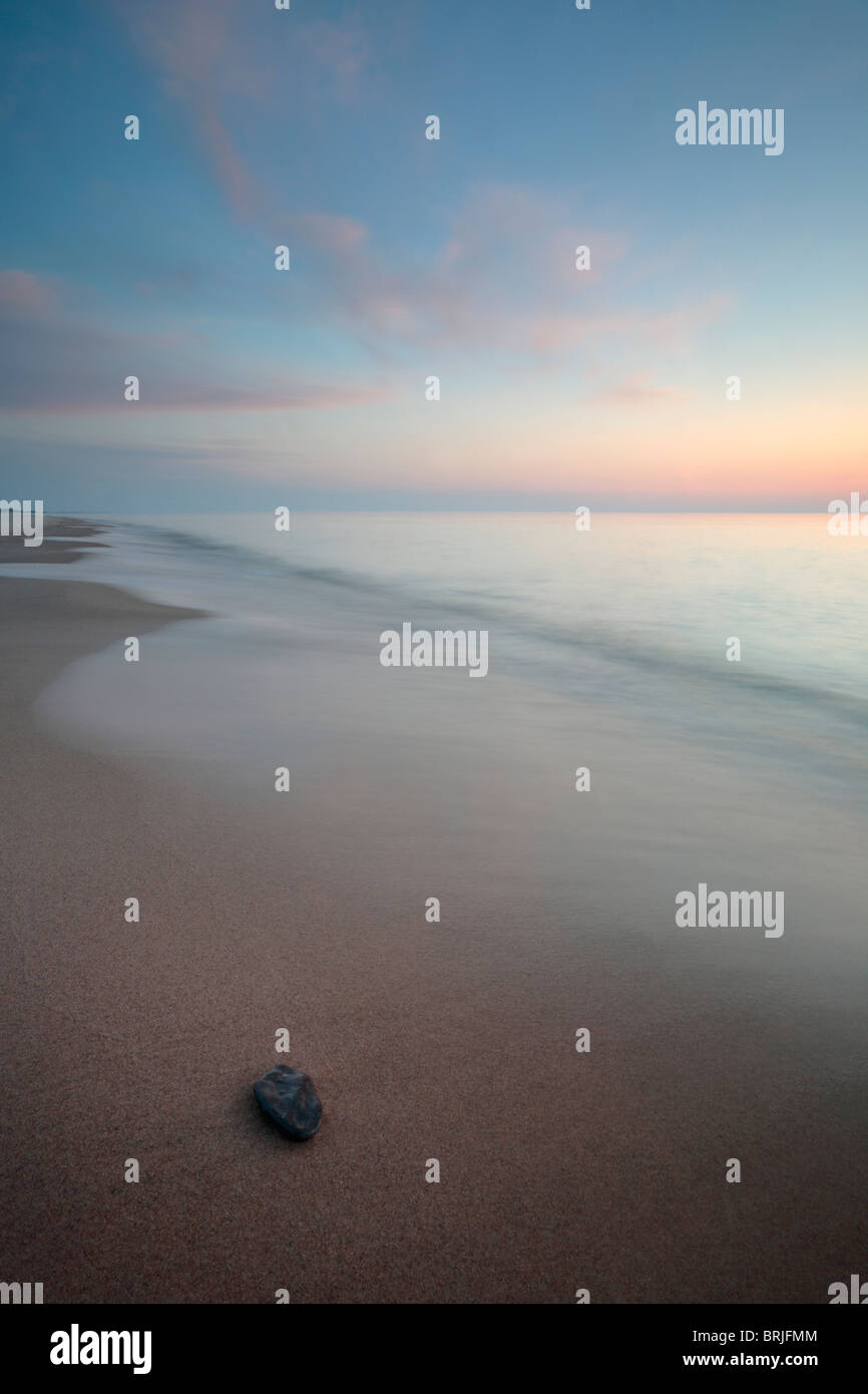 The quiet shores of Lake Michigan at twilight on a summer evening - Stock Image