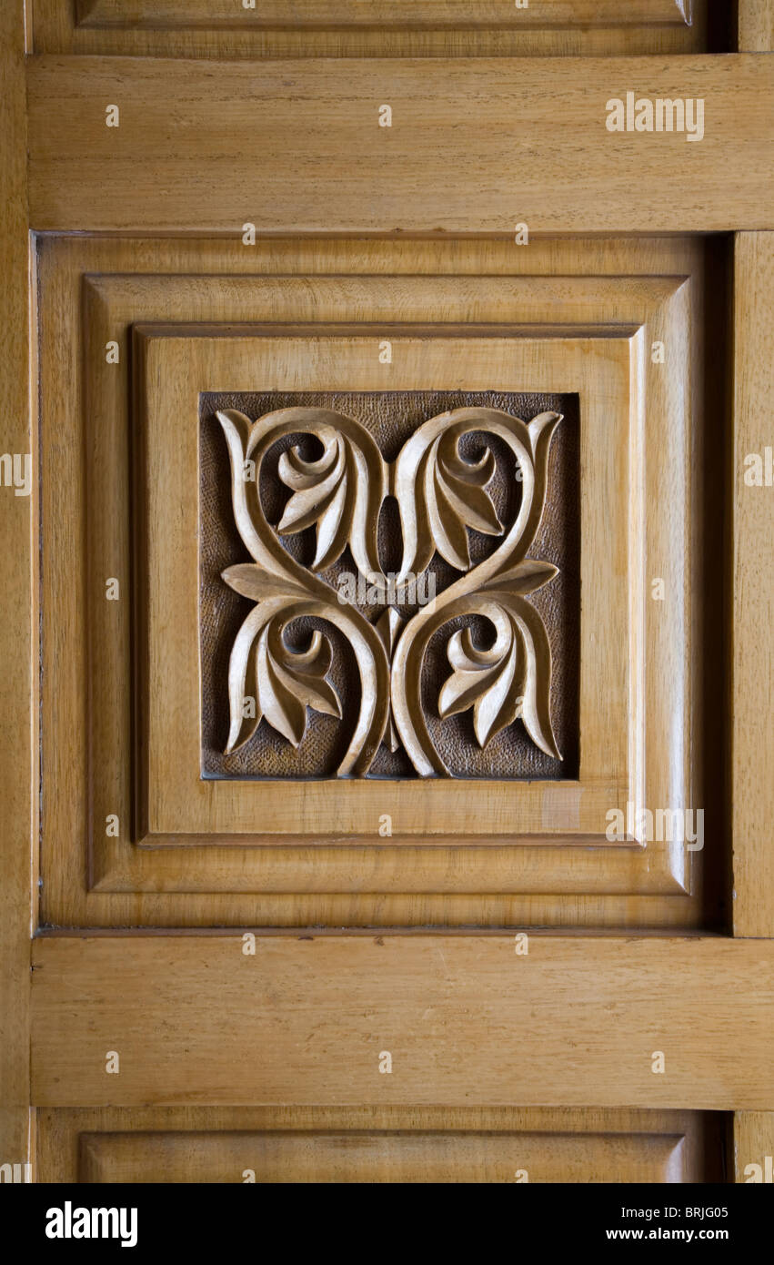Flower engraving in wooden Christian church door square symmetrical decoration four leaf symbol brown art Christianity anaglyp & Flower engraving in wooden Christian church door square symmetrical ...