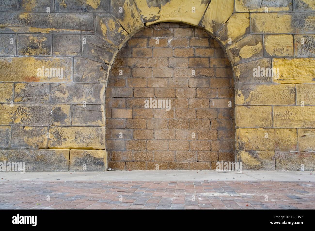 Arching Brick Wall - Stock Image
