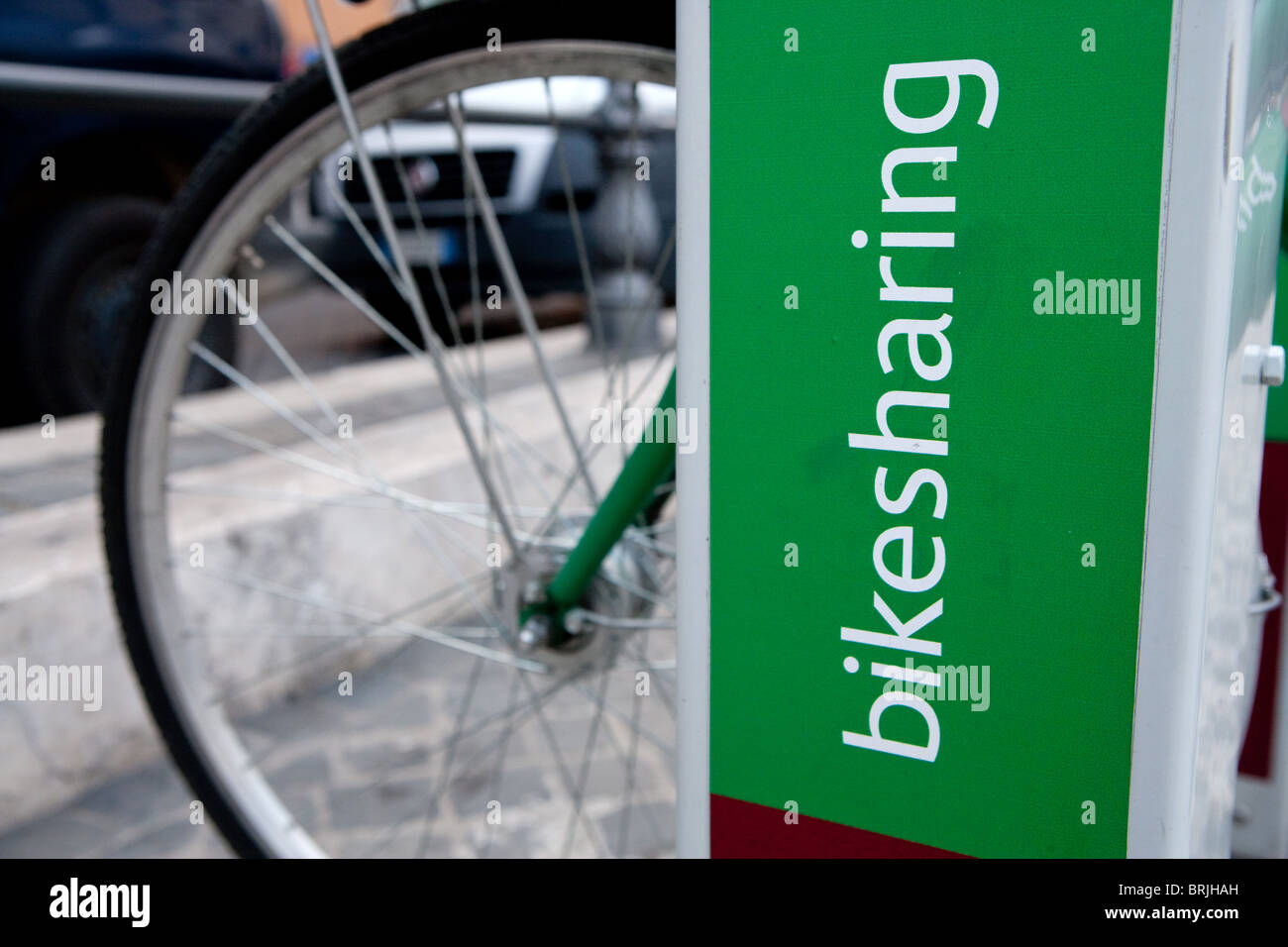 Bikesharing Bicycles for hire  cycling urban transportation city life transportation Rome Italy - Stock Image