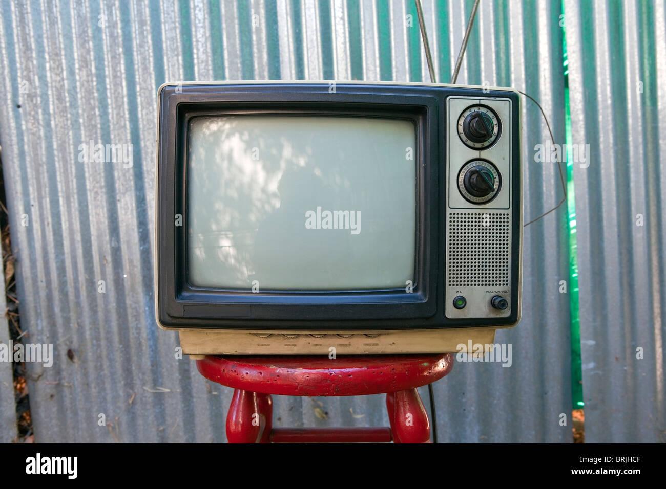 Beat up backyard TV set awaits another broadcast. - Stock Image