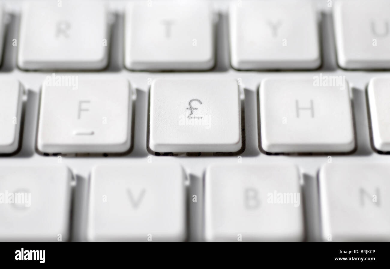 Great Britain Pound Symbol On Laptop Computer Keyboard Stock Photo