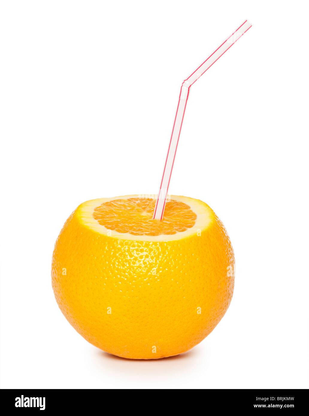 Orange with coctail straw isolated on white background - Stock Image