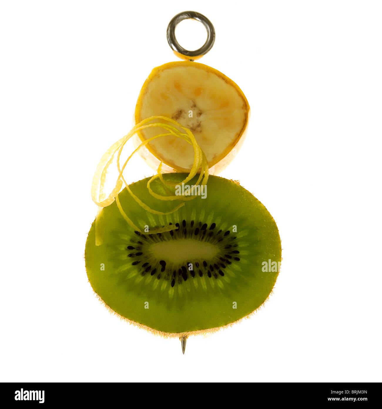 Banana, kiwi and lemon zest on skewer - Stock Image