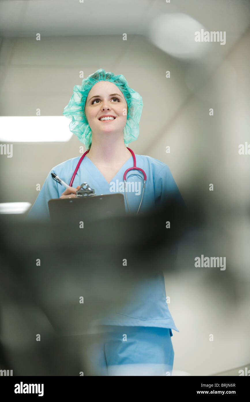 Nurse wearing surgical cap, low angle view - Stock Image