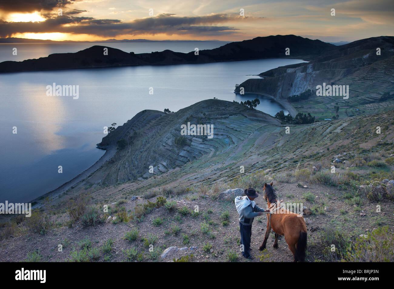 a campesino with his horse on Isla del Sol, Lake Titicaca, Bolivia Stock Photo