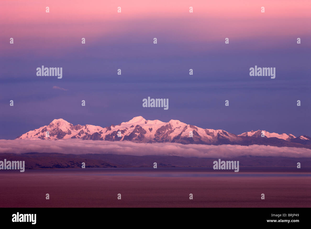 the Cordillera Real in the Andes from Lake Titicaca at dusk, Bolivia - Stock Image