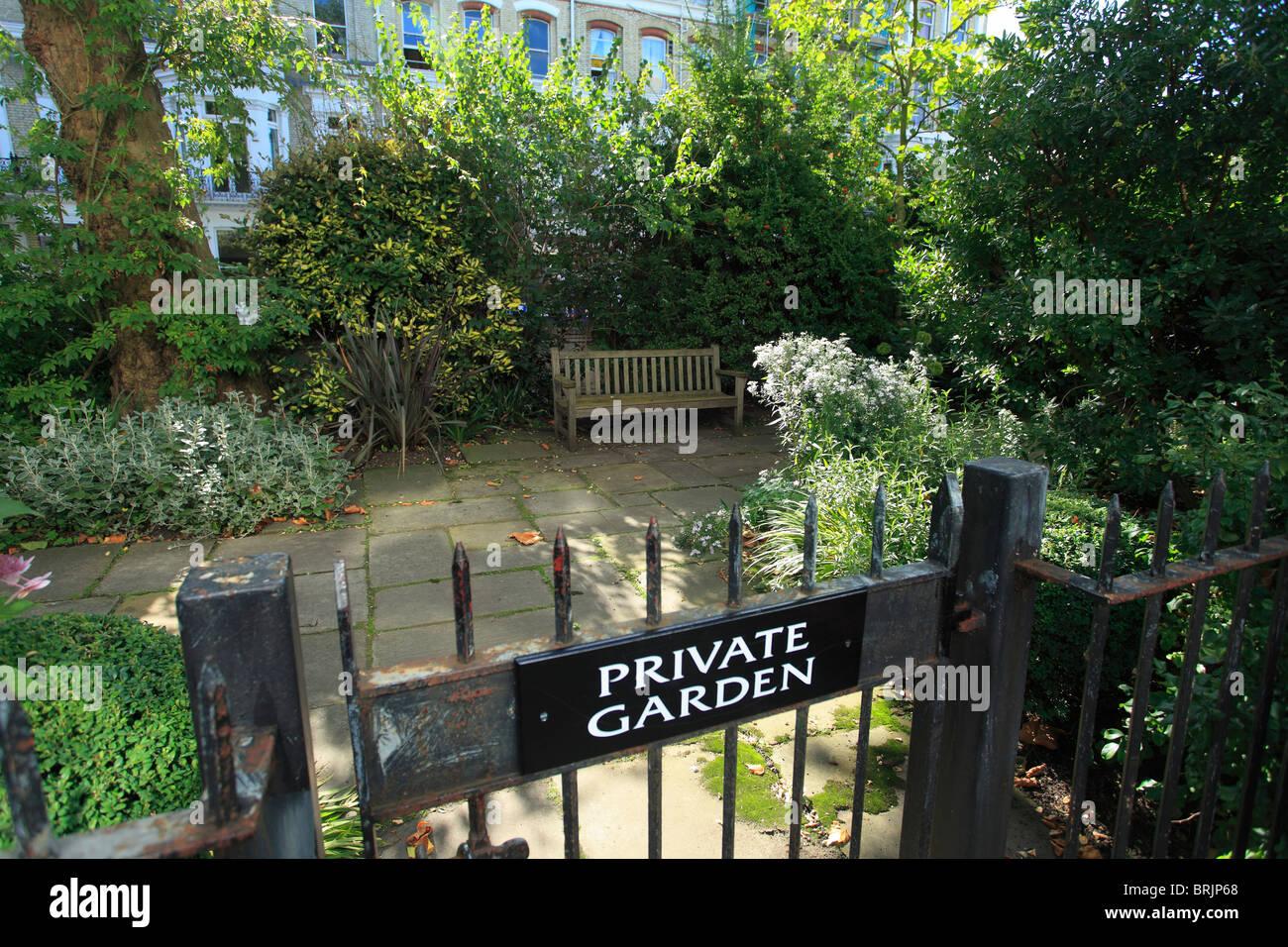 Private communal Garden in Kensington in London - Stock Image