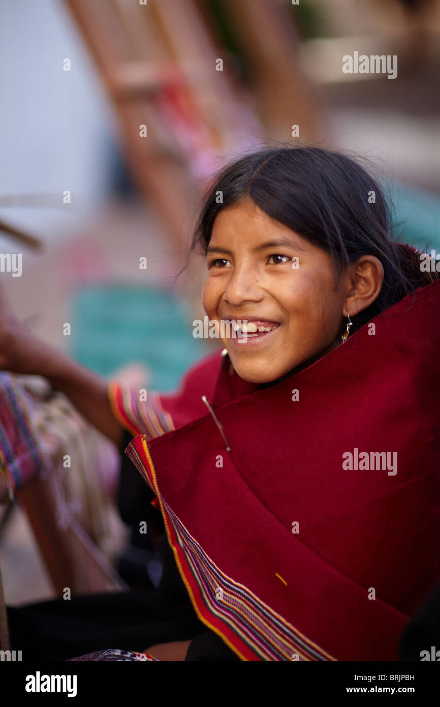 a girl at a weaving school in Sucre, Bolivia - Stock Image