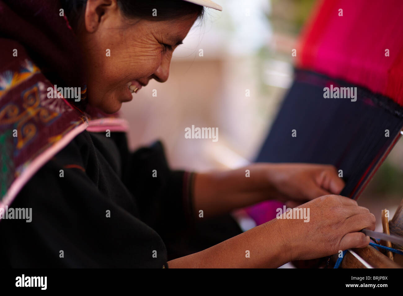 a woman at a weaving school in Sucre, Bolivia Stock Photo