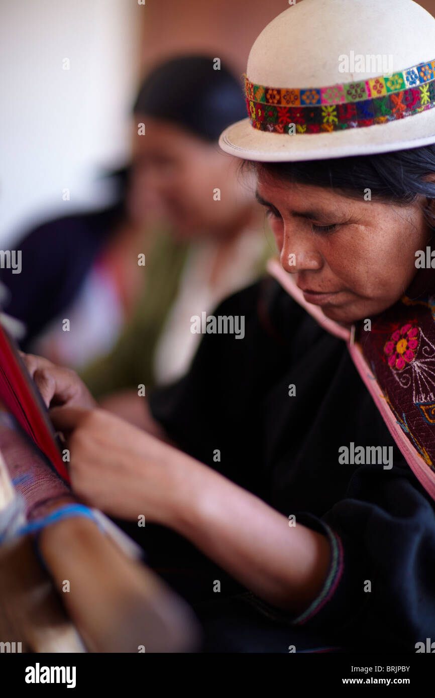 a woman at a weaving school in Sucre, Bolivia - Stock Image