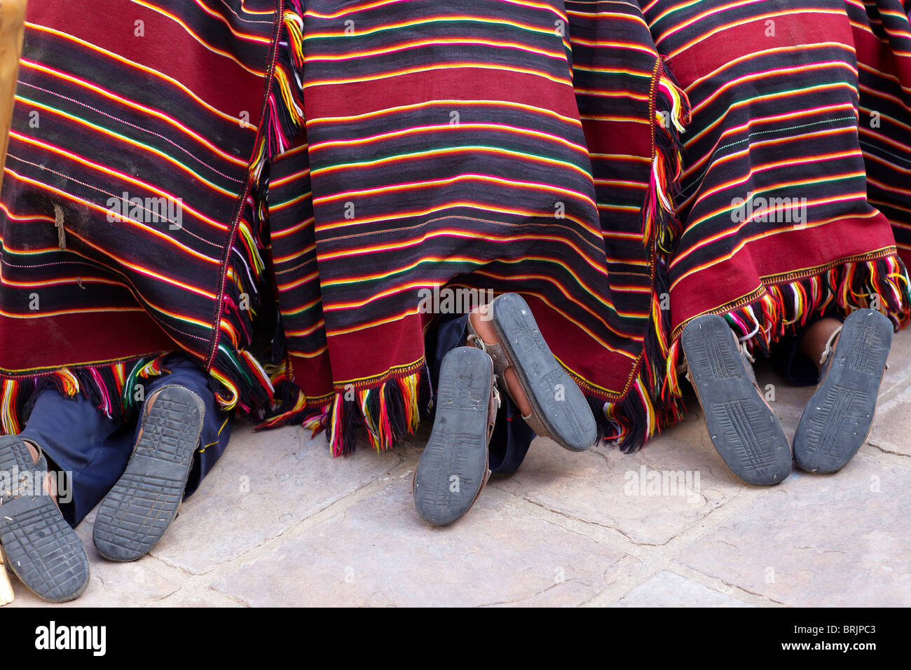 feet of boys at a weaving school in Sucre, Bolivia - Stock Image