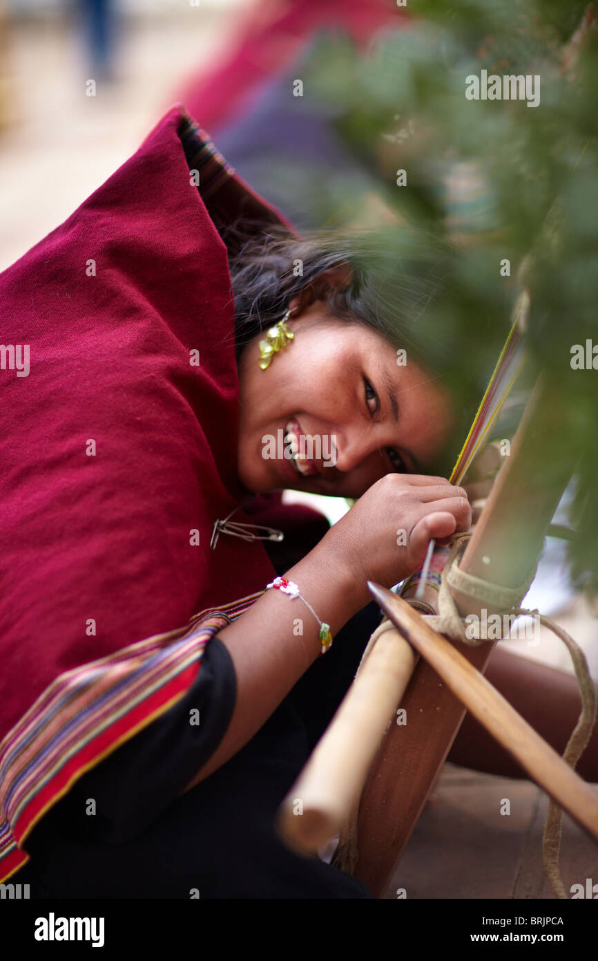 a shy girl weaving, Sucre, Bolivia - Stock Image