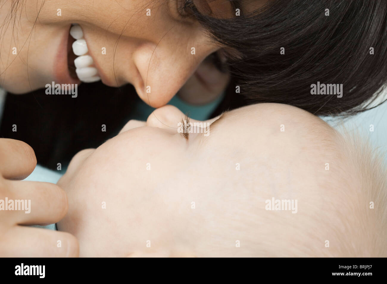 Mother nuzzling baby - Stock Image