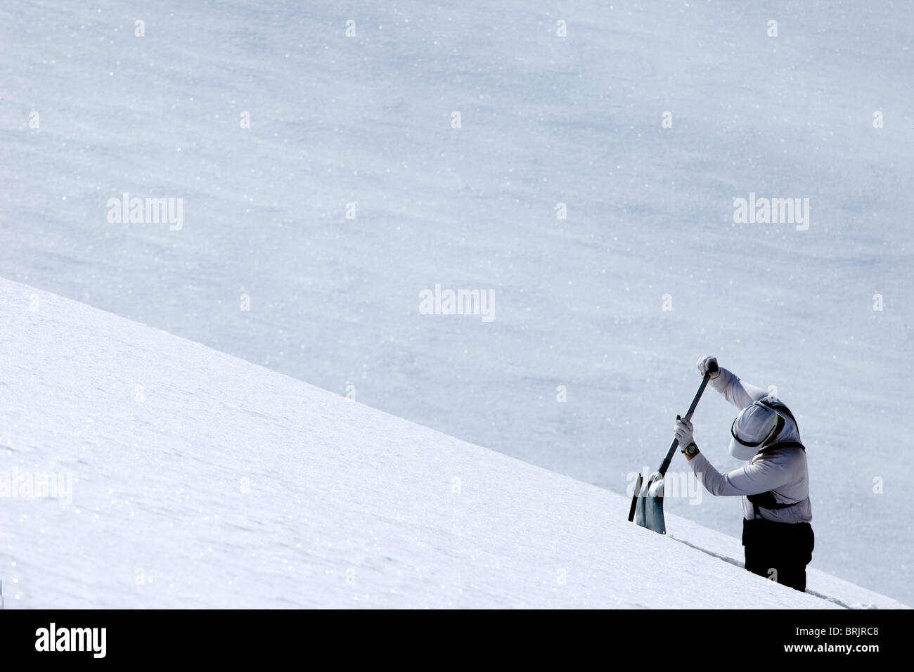 One man digging a pit in the snow. Stock Photo