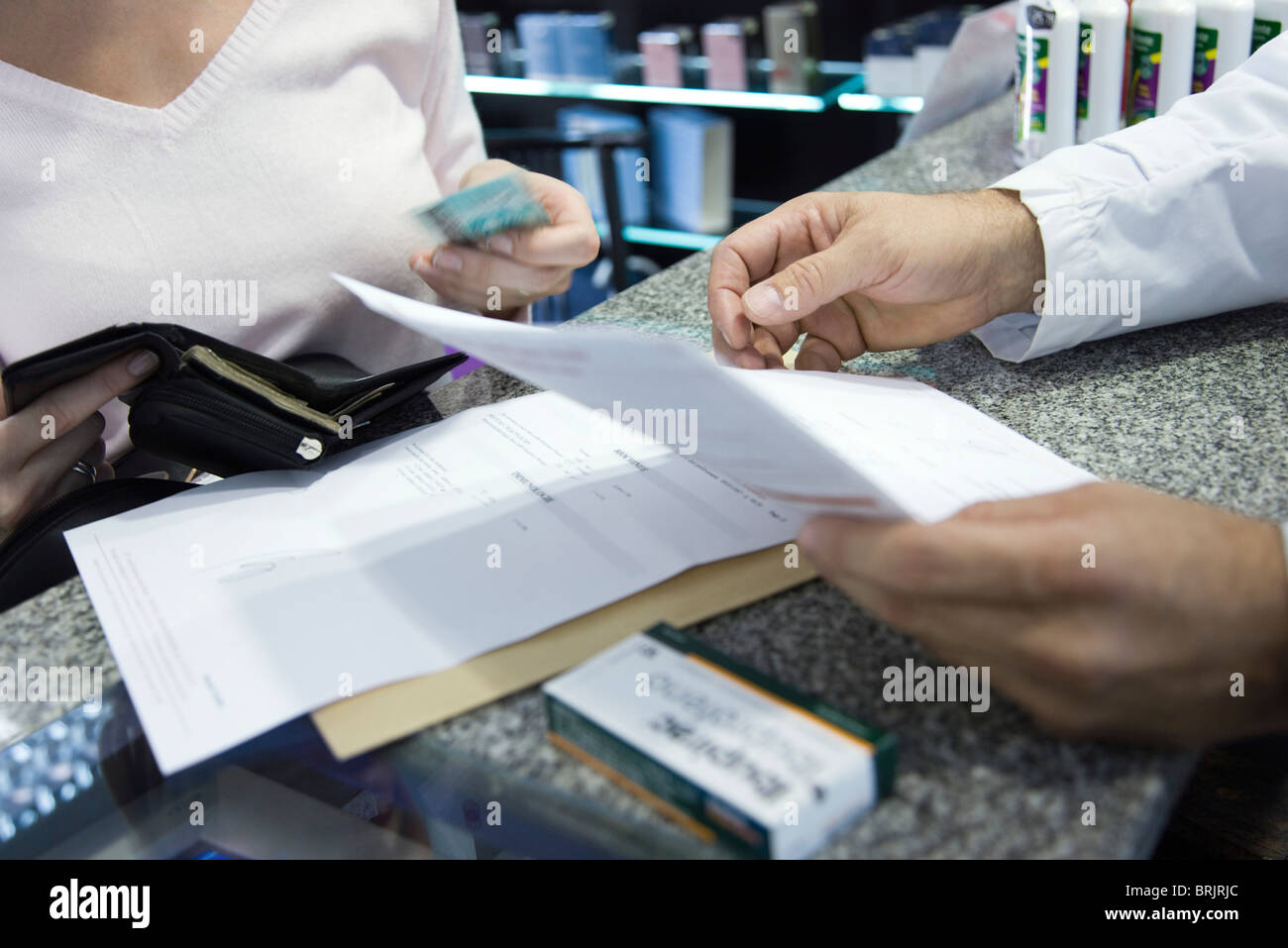 Customer paying for prescription, cropped - Stock Image