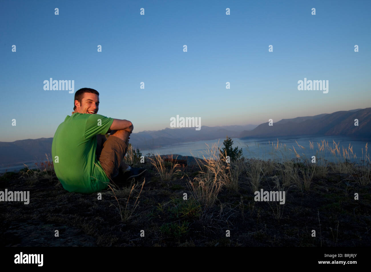 Young man hiking at sunset in Idaho. - Stock Image
