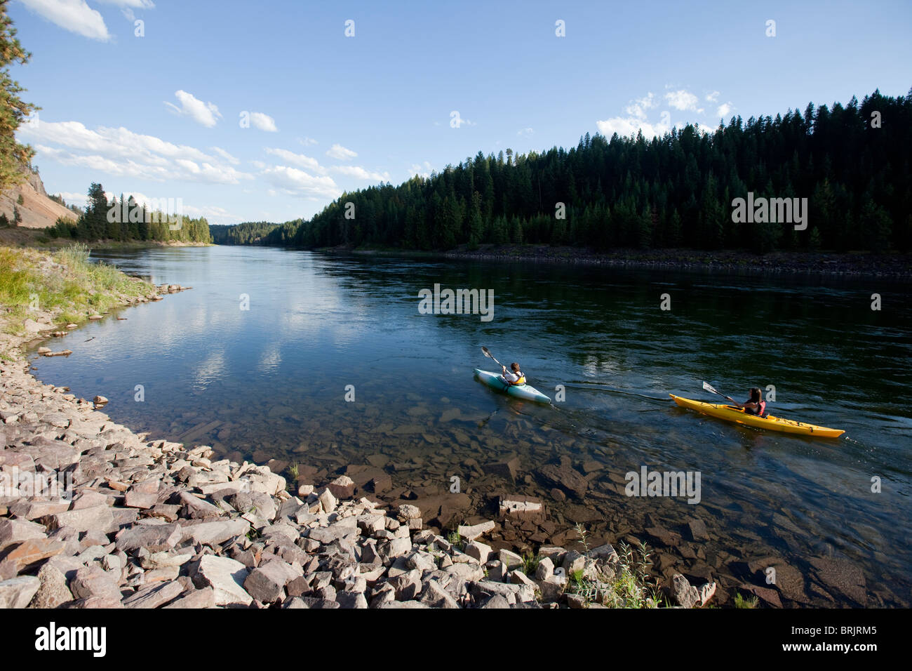 Young adult couple kayak on a beautiful summer day in Idaho. - Stock Image