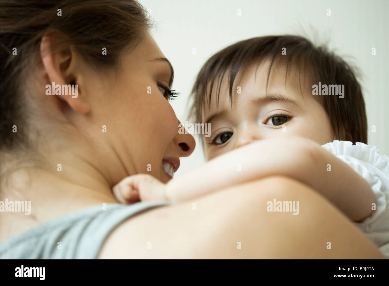 Mother holding baby girl - Stock Image