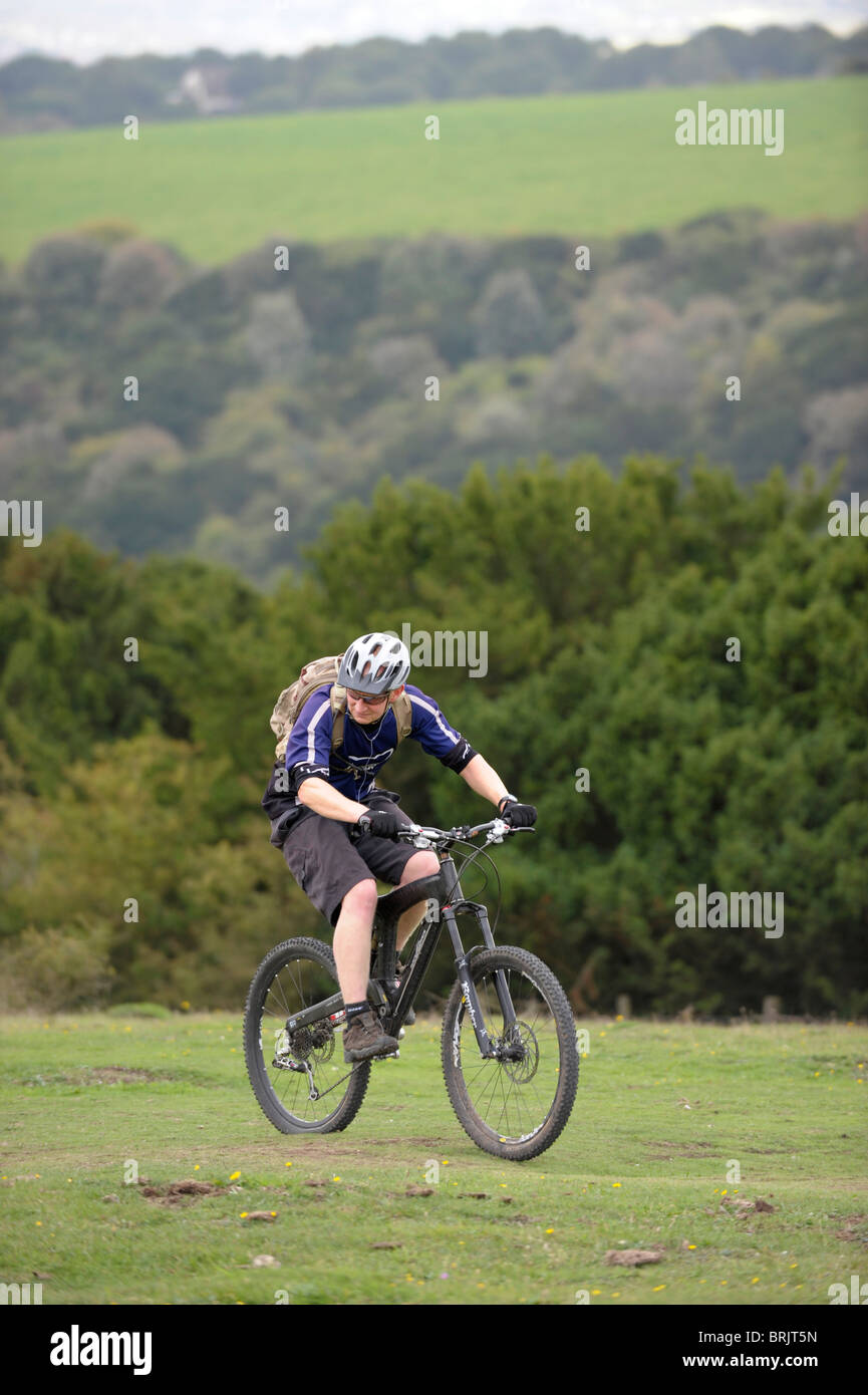 Mountain biker on Butser Hill, in the South Downs National Park, Hampshire, England Stock Photo
