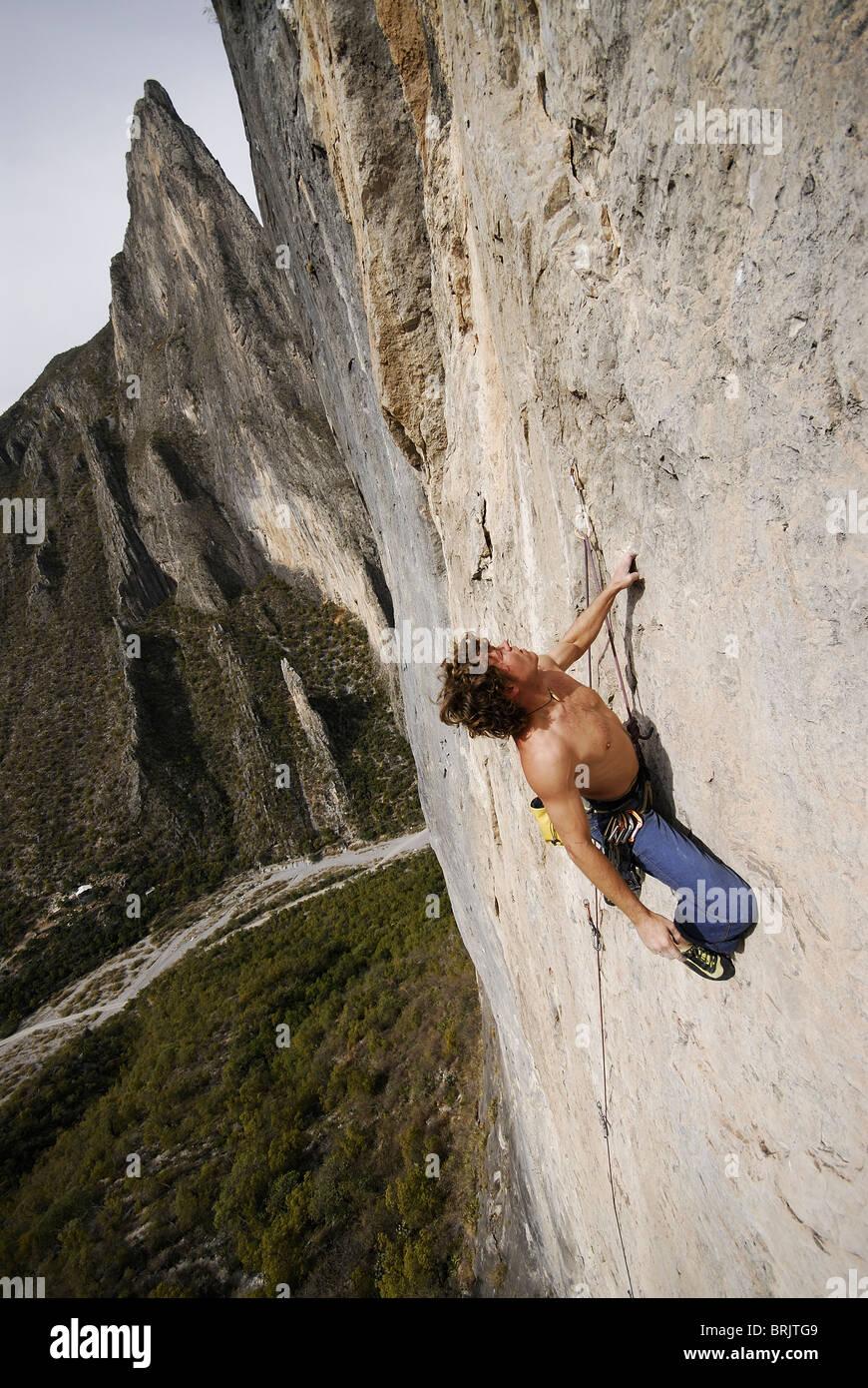 A rock climber ascends a steep rock face in Mexico. Stock Photo
