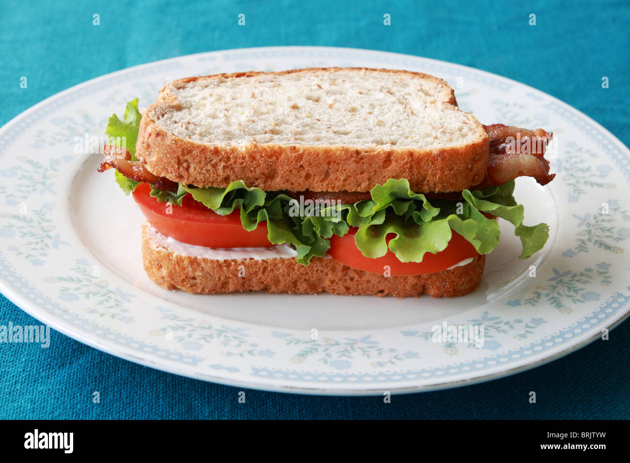 BLT or bacon lettuce and tomato sandwich on a plate - Stock Image