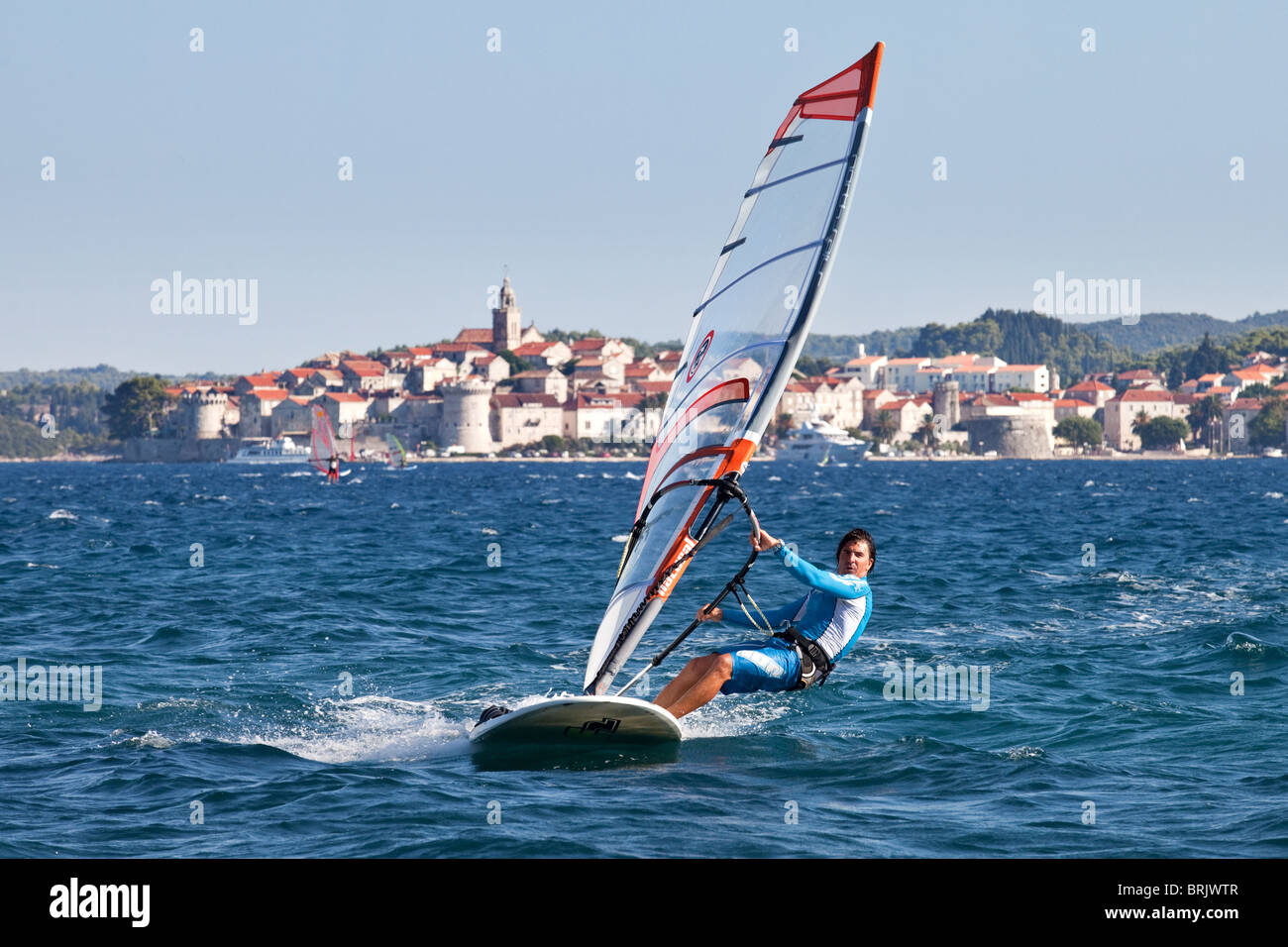 Windsurfing in Croatia in the background Korcula, Dalmatian coast, Croatia - Stock Image