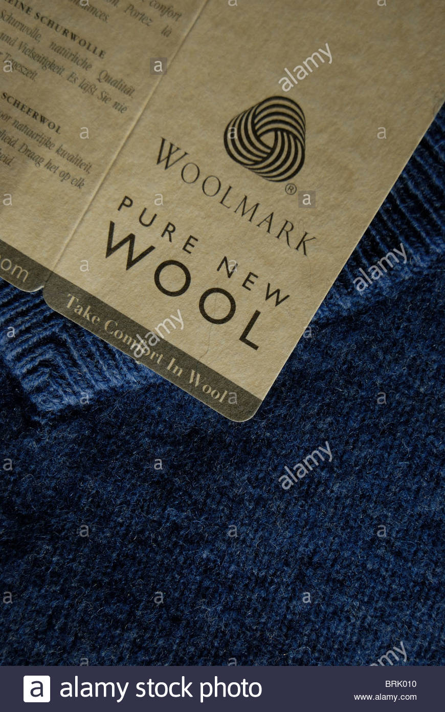 Woolmark on a label of a new blue woolen jumper. - Stock Image