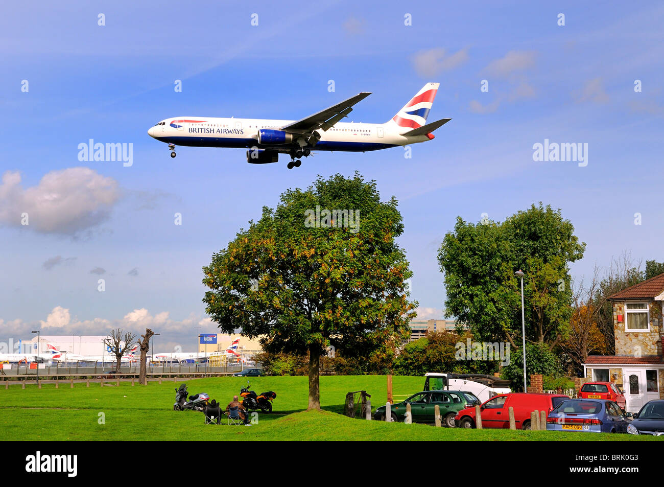 Low flying passenger aircraft landing at Heathrow  airport, London Stock Photo
