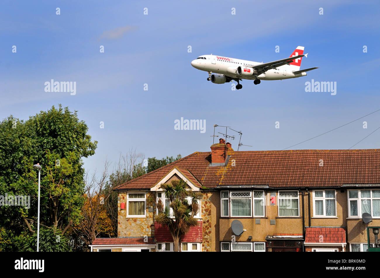 Low flying passenger aircraft landing at Heathrow  airport, London - Stock Image