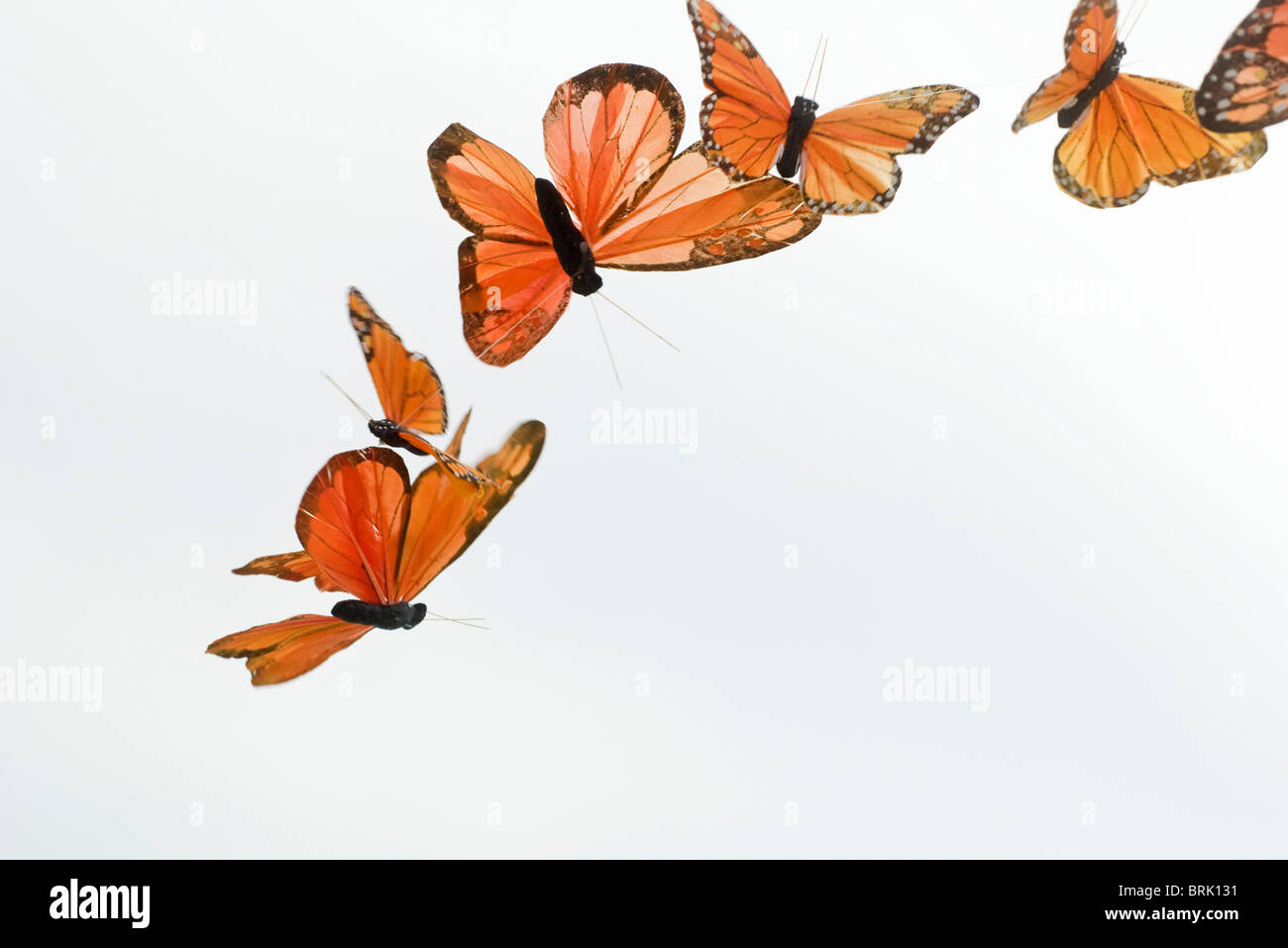 Artificial butterflies flying - Stock Image
