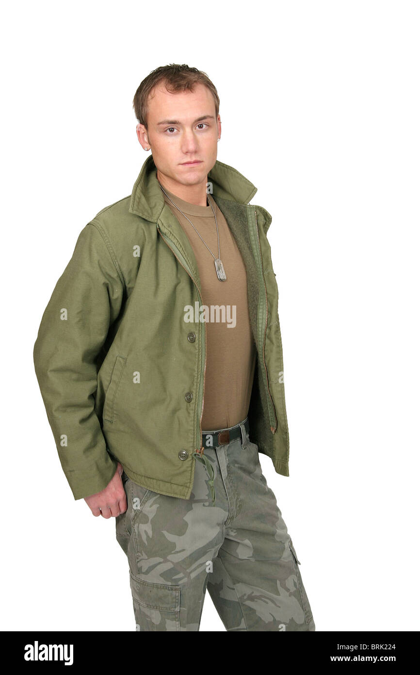 one fit attractive soldier in green and brown with dogtags and jacket half length portrait over white - Stock Image
