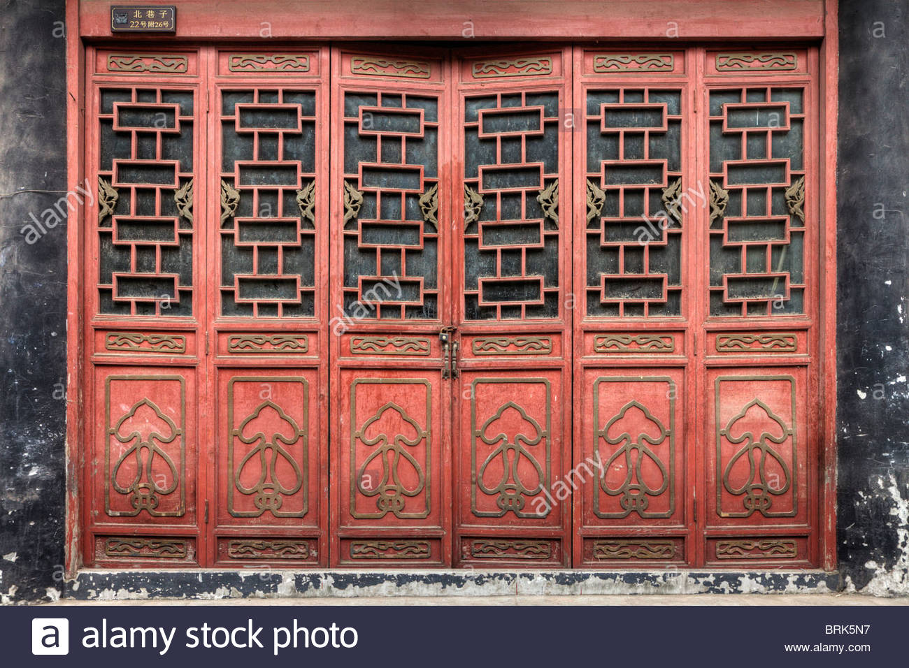 Decorative antique wood carved doors on Jinli Old Street. - Stock Image
