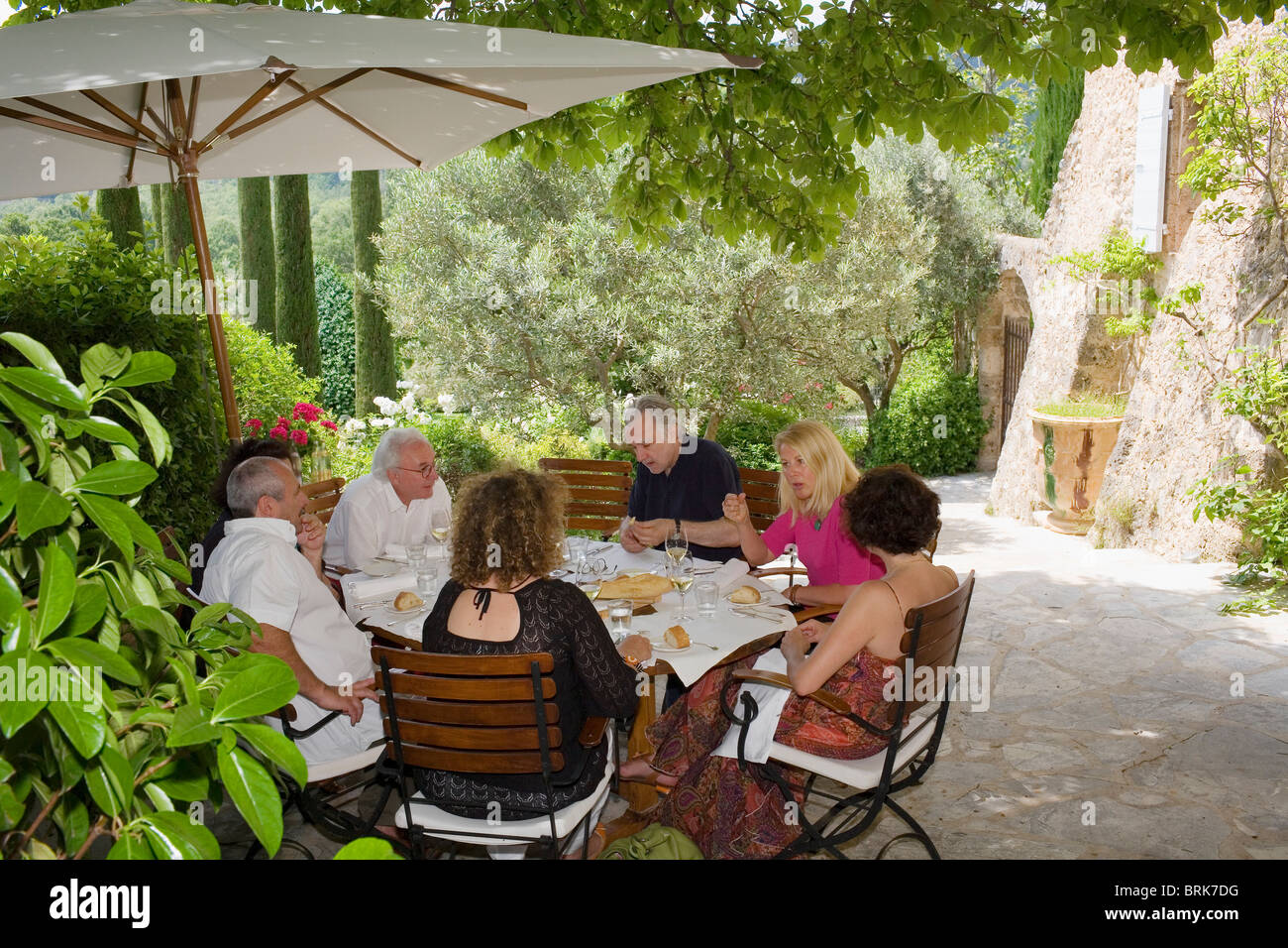 Alain Ducasse with friends at his restaurant La Bastide de Moustiers ...