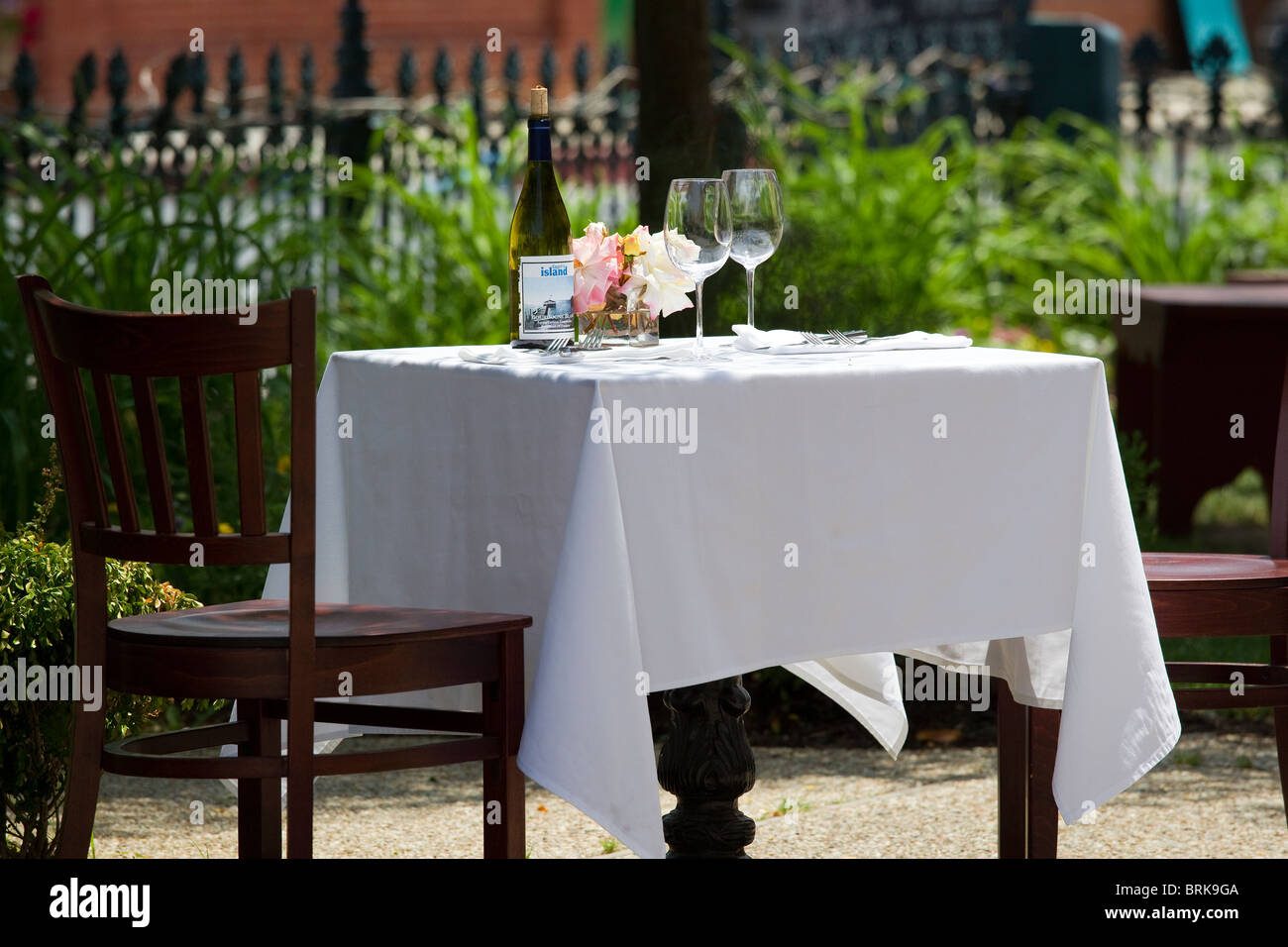 Wine Glasses And Wine Bottle On Table With White Table Cloth