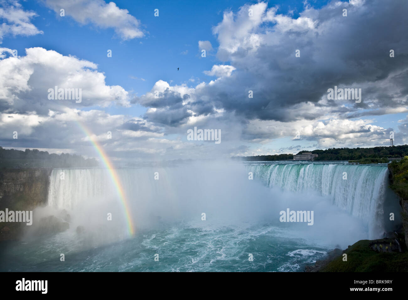 Rainbow and spectacular clouds over Horseshoe Falls, Niagara Falls, Ontario, Canada - Stock Image