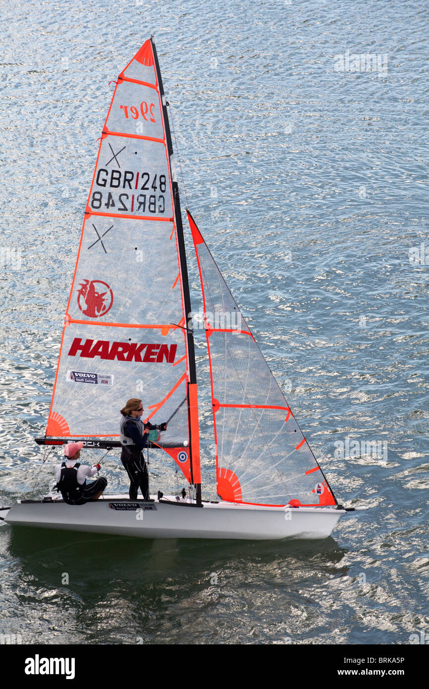 Crew sailing GBR dinghy boat in the solent - Volvo Youth Sailing Team GBR - Stock Image