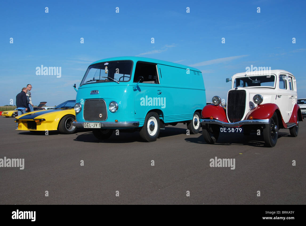 Ford cars from different eras on display, among them a German registered Ford Taunus utility van and a 1930s Ford - Stock Image